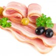 Tasty sliced pork bacon with parsley and olives — Stock Photo #5583817