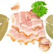 Tasty sliced bacon with laurel, parsley and garlic - Stock Photo