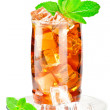 Glass of iced tea with ice cubes and mint - Stock Photo