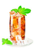 Glass of iced tea with ice cubes and mint — Stock Photo