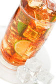 Glass of iced tea with ice cubes, lime and mint — Stock Photo