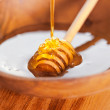 Bowl of fresh honey - Stock Photo