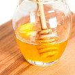 Fresh honey in glass jar - Stock Photo