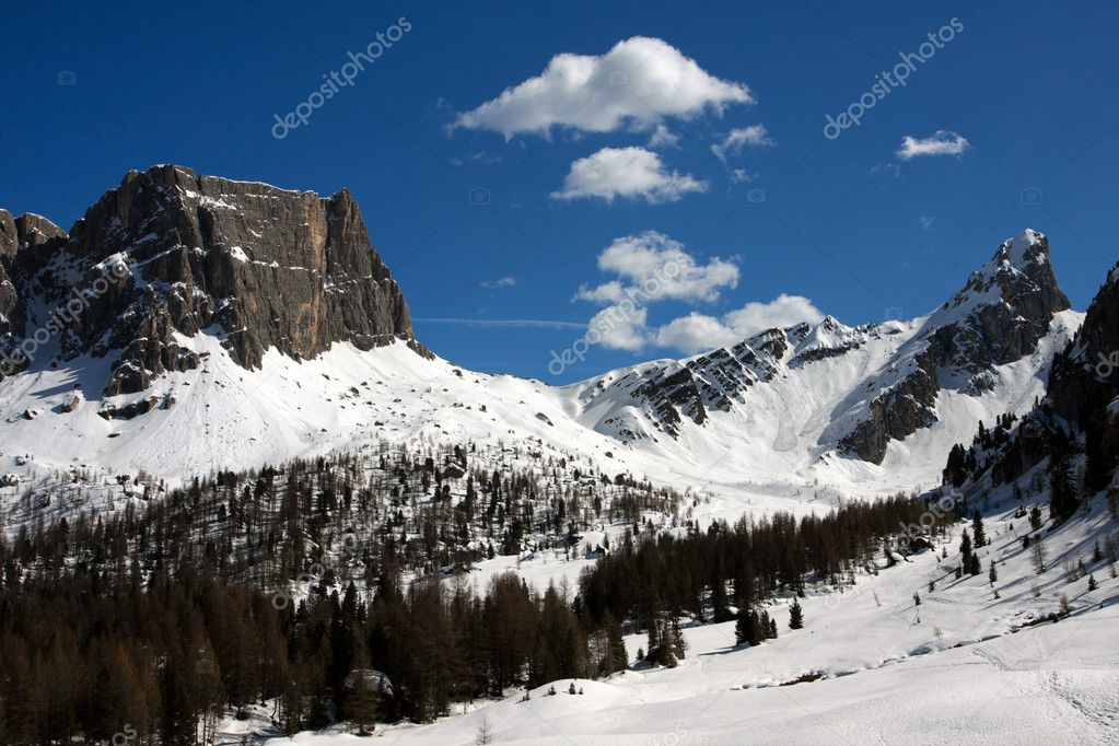 Wide snowed valley with snowed mountains in the distance  Stock Photo #5501634