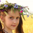 Girl with flowers diadem on her head — Stock Photo