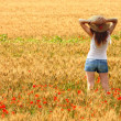 Girl on a wheat field — Stock Photo