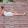 Girl lying on a stairs — Stock Photo