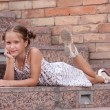 Girl lying on a stairs — Stock Photo #6582939