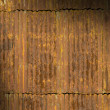 Stock Photo: Rusty corrugated metal roof panels lit diagonally