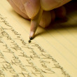 Handwriting with broken pencil point on yellow pad — Stock Photo