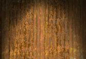 Rusty corrugated metal surface dramatically lit — Stock Photo