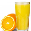 Drinking glass with orange juice and oranges near — Stock Photo
