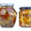Glass jars with olives and seafood — Stock Photo