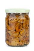 Chanterelle mushrooms marinated in the glass jar — Stock Photo