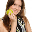 Woman holding a green apple — Stock Photo #5382599