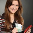 Woman with purse and paper money — Stock Photo
