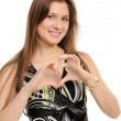 "Young girl showing ""heart"" with her fingers. — Stock Photo"