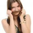 Girl with hairdo putting braid's tail end like moustache — Stock Photo