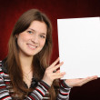Young woman holding empty white board — Stock Photo #5645468