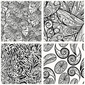 Four vector seamless monochrome patterns — Stock Vector
