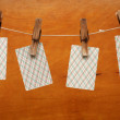 Royalty-Free Stock Photo: Playing cards (suits) hanging on a pin on a wooden background