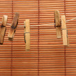 Vintage clothespin on Wood wall - Stock Photo