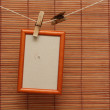 Photo frame hang on the clothespin on wood wall — Stock Photo
