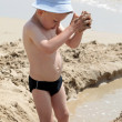 Little boy playing o the beach — Stock Photo #5760710