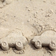 Car figures made of sand on Beach. Traveling by car — Stock Photo