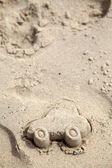 Car figure made of sand on Beach. — Stock Photo