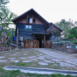 Wooden country house with beutiful garden - Stok fotoraf