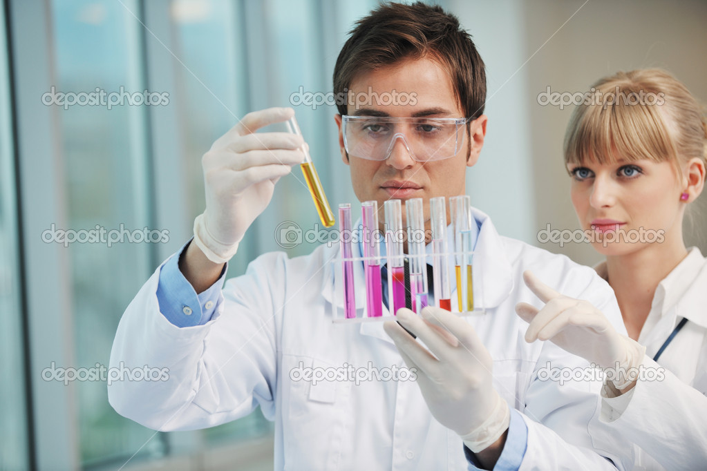 Science and research biology chemistry an dmedicine  youn couple in bright modern  lab — Stock Photo #5481916