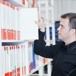 Male adult in archive library — Stock Photo