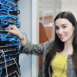 Royalty-Free Stock Photo: Woman it engineer in network server room