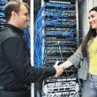 Young it engeneer in datacenter server room — Stock Photo #5550189