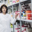 Woman worker in pharmacy company — Stock Photo #5555828
