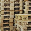 Stock Photo: Wooden palettes in warehouse