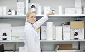 Woman worker in pharmacy company — Stock Photo