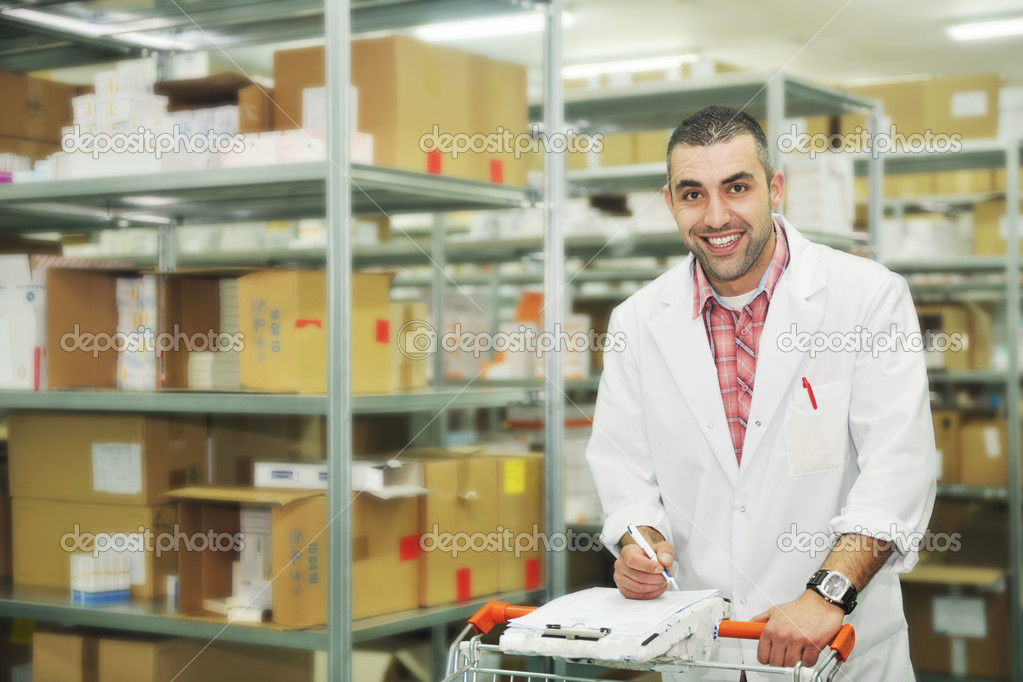 Medical factory  supplies storage indoor with workers — Stock Photo #5552371