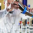 Stock Photo: pro barman prepare coctail drink on party