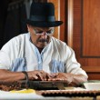 Man making luxury handmade cuban cigare — Stock Photo #5607055