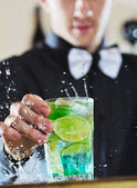 Pro barman prepare coctail drink on party — Stock Photo