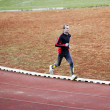 Adult man running on athletics track — Stock Photo #5647287