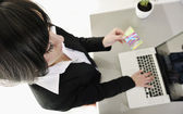 Business woman making online money transaction — Stock Photo