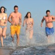 Happy group have fun and running on beach — Stock Photo