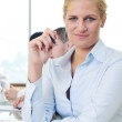 Young business woman on meeting — Stock Photo #5711191