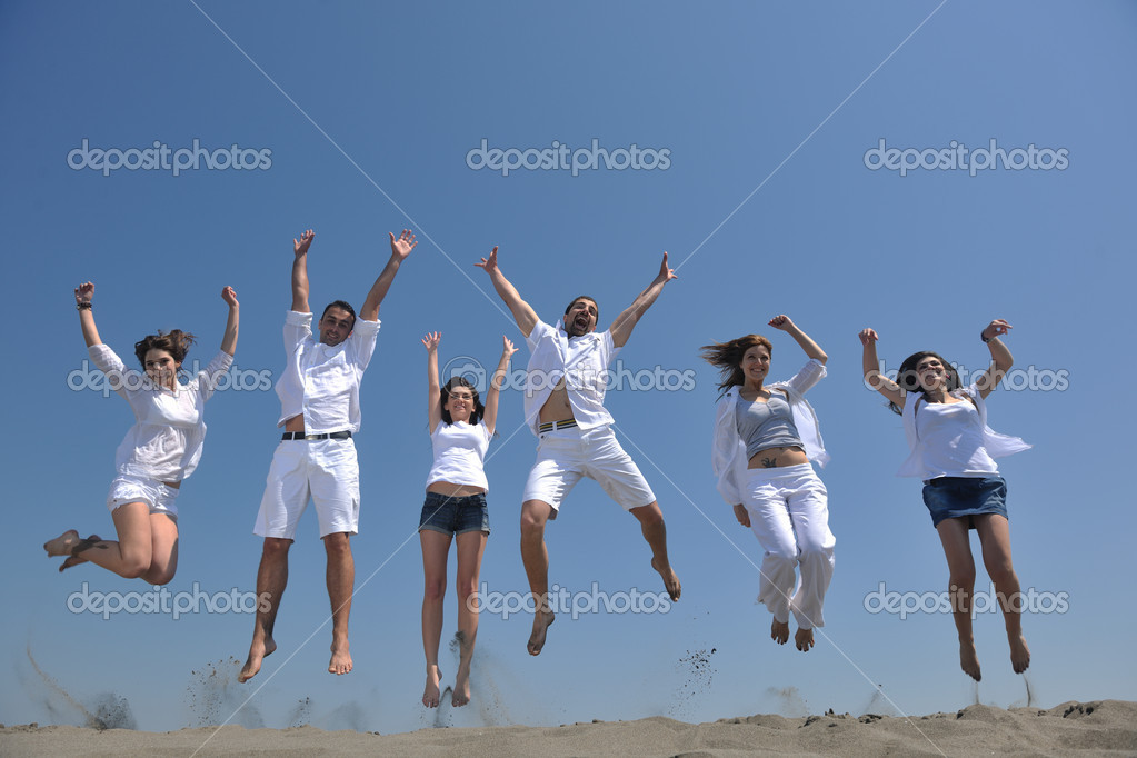 Happy group have fun  run and jump  on beach beautiful sand  beach — Stock Photo #5710590