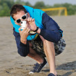 Amateur photographer taking snapshot photo — Stock Photo