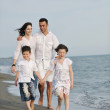 Happy young family have fun on beach — Stock Photo #5741248