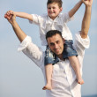 Happy father and son have fun and enjoy time on beach — Stock Photo #5743404